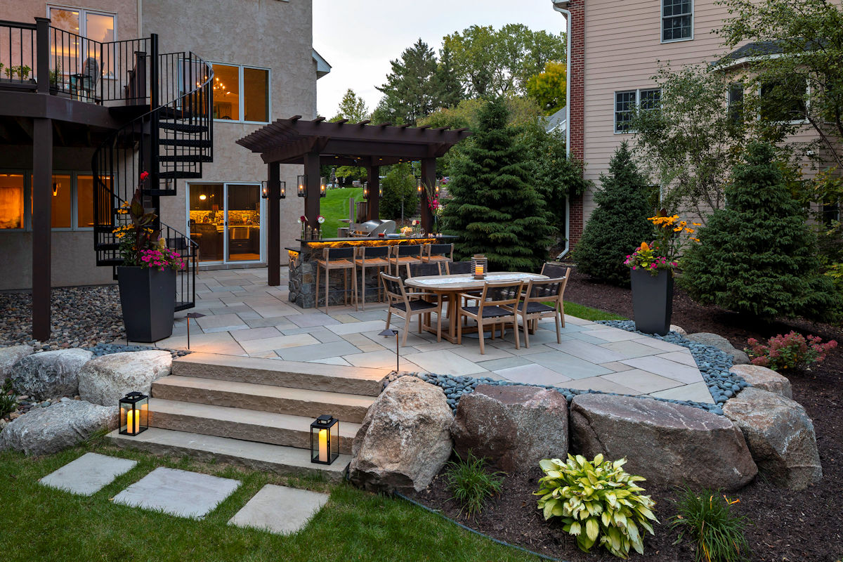 Brewed Elegance spiral staircase and outdoor dining area by LIVIT