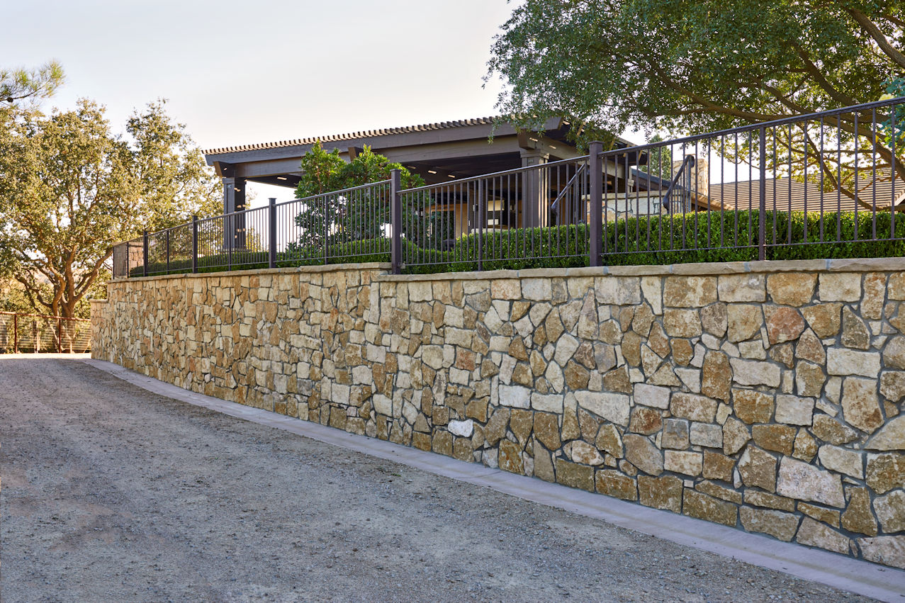 retaining wall with hedges in Coastal Retreat Project by Tim Johnson at LIVIT