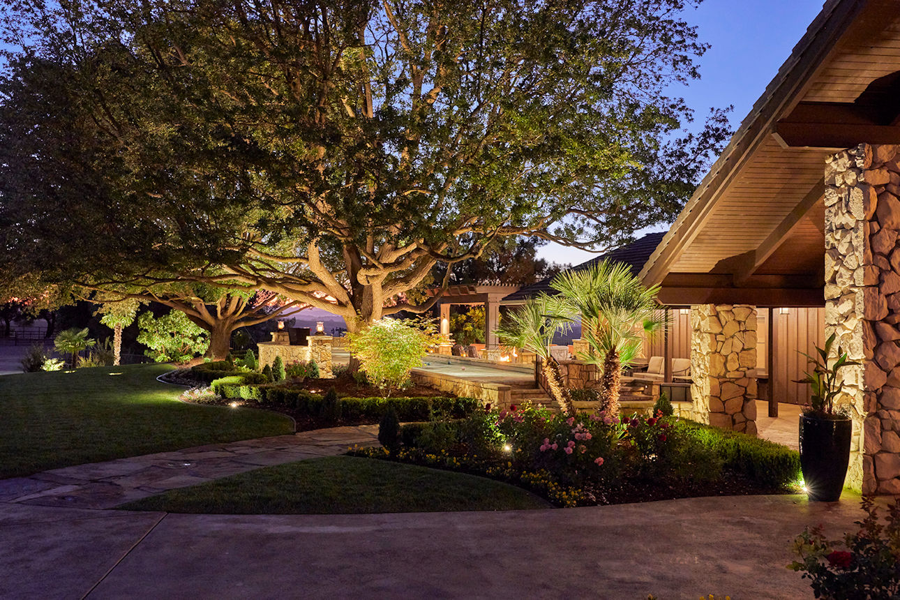 custom outdoor lighting and landscaping in Coastal Retreat Project by Tim Johnson at LIVIT
